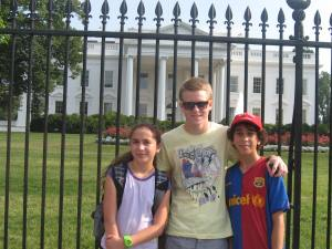 Graz delegate Simon Scheikl (center) with his Detroit Interchange partner, Bryce Owens, and Bryce's sister, Leila Owens, standing in front of the White House during their family vacation trip.
